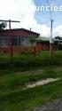 Amplio terreno con dos casas de habitaci