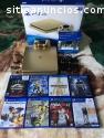 Sony PS4 ORO 1TB con 8 juegos $150usd